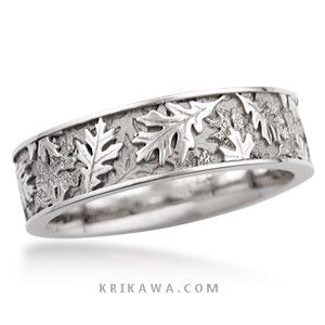 Layers of oak leaves in relief cover the surface of this wedding band. This nature-inspired ring can be made in the precious metal and width of your choice.