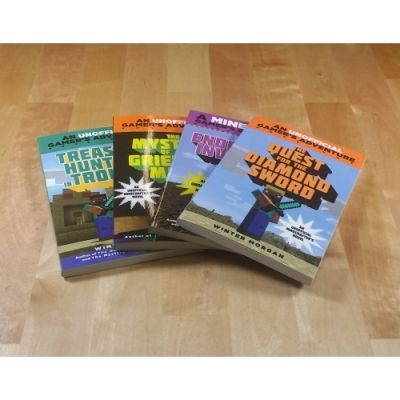 """Start building your Minecraft library! Pick up Minecraft fiction or Minecraft how-to """"hack"""" books."""