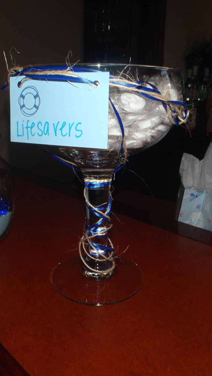 Nautical bridal shower decoration-Lifesavers in an oversized margarita glass with twine and blue ribbon.