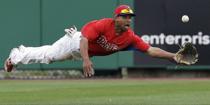 Philadelphia Phillies center fielder Ben Revere makes a diving catch of Will Middlebrooks's seventh-inning fly ball in a spring training baseball game against the Boston Red Sox in Clearwater, Fla., Sunday, March 24, 2013. (Kathy Willens / AP)