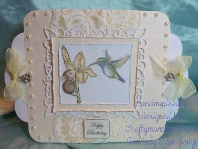 Anyway enough ramble, today's card is house mouse again (lol just love those little mice, can you tell? hehe) I have cut out the card base with Spellbinders grand dies, used some plain pale yellow card, the image is of course a House Mouse stamp and was coloured in with Promarkers and then layered on to Marianne Design dies and some lace and then I have just decorated with a lot of pearls, a glittered sentiment (although the glitter doesn't show up very well on the pics) and tied some…