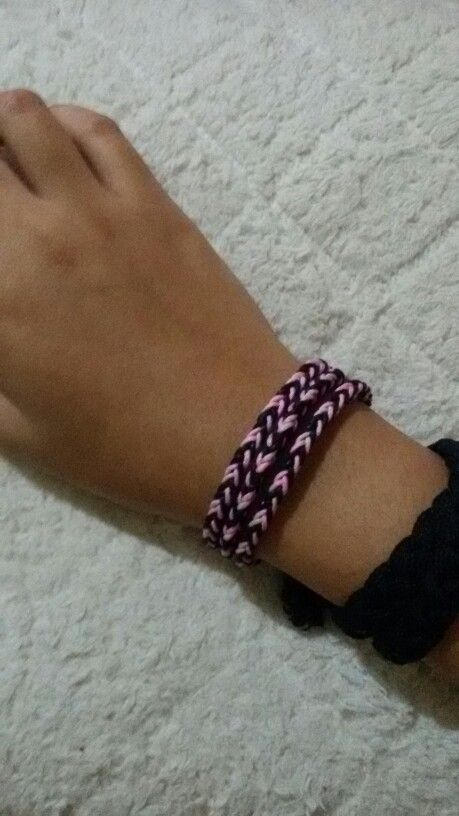 My first eight strands square braid. It's pink-black-pink-black on the right and pink'pink-black-black on the left.   Not my best, but i tried