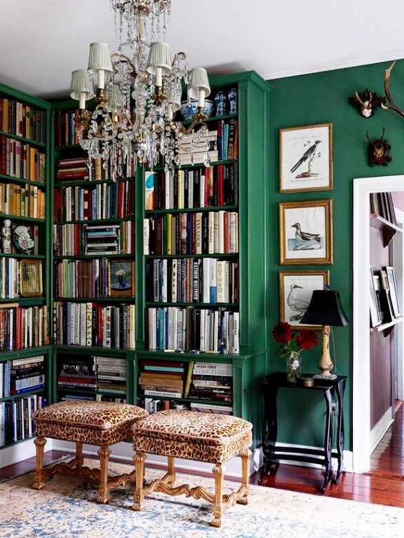 Library with green walls, leopard stools, and antique chandelier. // #kellywearstlerXdomaine