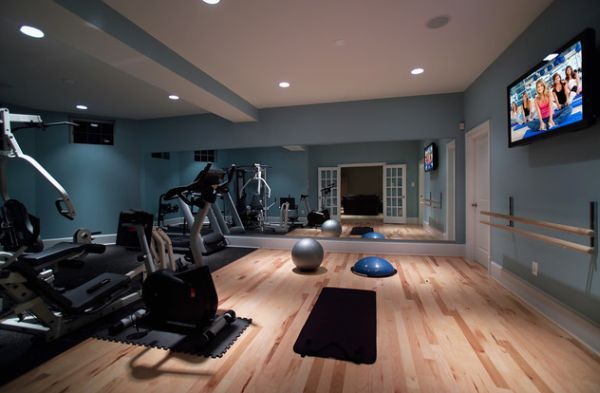 Stylish basement home gym and dance studio. Wall mounted mirrors, TV and painted walls