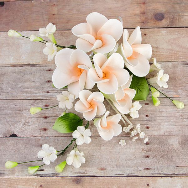 THIS ITEM IS FINAL SALE Plumeria, also known as Frangipani, symbolize new life, perfection and springtime. These gorgeous readymade by hand from gumpaste flowers are perfect for weddings, birthdays an