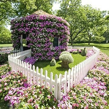 "Gazebo covered in flowers and ""its own"" personal garden."