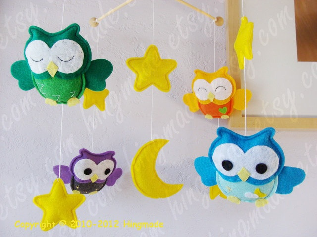 Baby Mobile - Owl Mobile - Nursery Mobile - Rainbow Colorful Mobile - Yellow Orange Green Blue Purple Owls theme (You can pick your colors). $95.00, via Etsy.