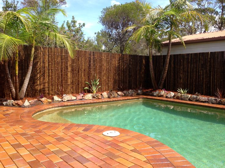 Pool area, paving, bamboo screen, tropical planting
