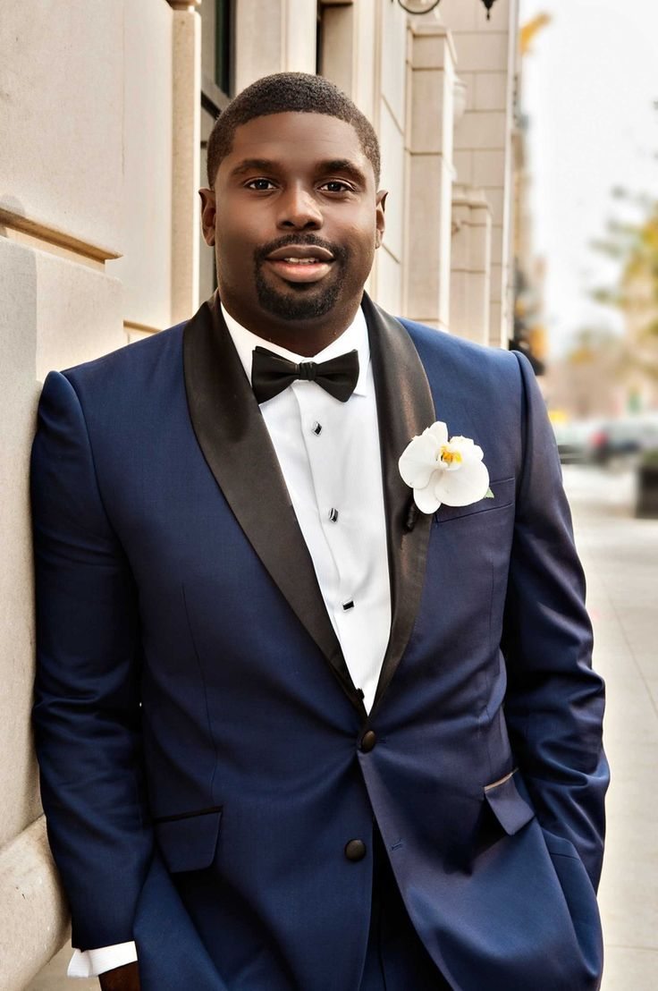 Stylish Groom with Navy Blue Tuxedo | Photography: Carasco Photography. Read More: http://www.insideweddings.com/weddings/church-ceremony-with-nigerian-traditions-chic-ballroom-reception/845/