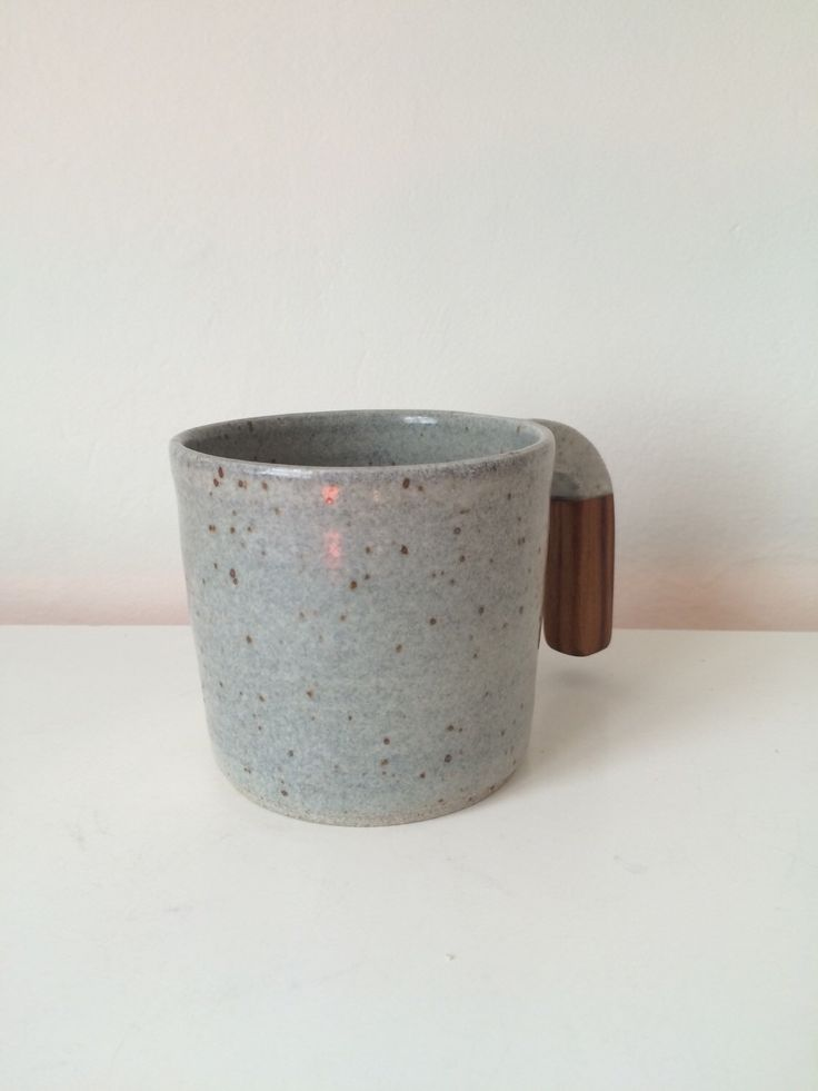 A personal favorite from my Etsy shop https://www.etsy.com/ca/listing/287199437/handmade-ceramic-wood-handled-mug-in