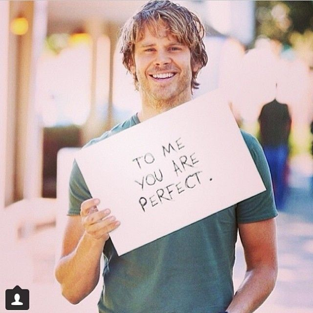 Ericolsen (instagram) I'm looking directly into the camera which can only mean that YOU are perfect to me.#weknowthatididntmakethesignbecaiseallthewordsatespelledcortecrly