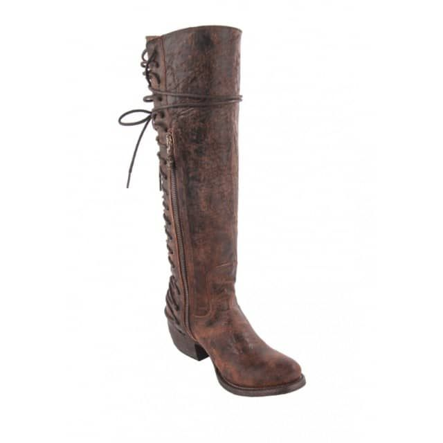 """Finally a boot that is as unique and feminine as you are! This ultra chic Idlewild Boot features soft rich bown distressed leather with a unique corset, lace up back and a side zip. Finished off with a comfortable round toe, 15"""" shaft and 1.75"""" heel. Whether you are wearing your favorite white Summer dress or comfy flannel and leggings these boots will be a constant go to!"""