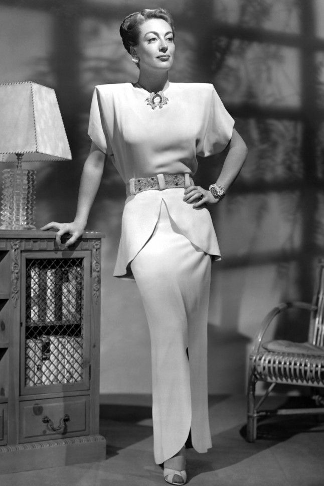 1940. Joan Crawford, Check out Crawford's shoulder pads and decadent jewels – now we know where Joan Collins got her 1980s style inspiration from. A perfectly-tailored peplum finishes off her sharp look. Power dressing at its very best. - Marie Claire UK
