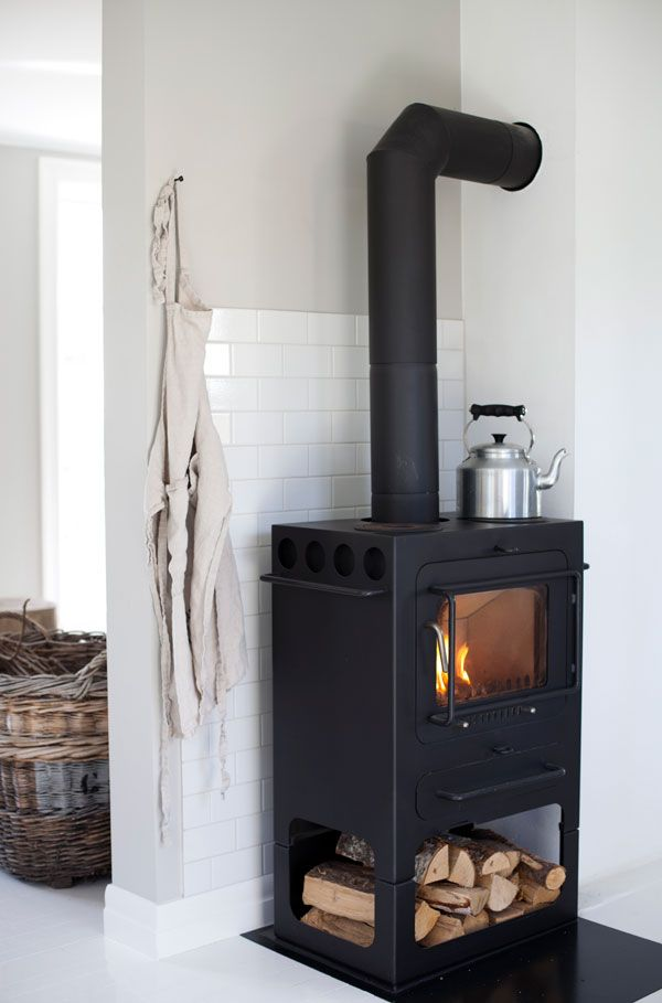 A kitchen is an excellent space for a wood burning stove! - find more wood burning stoves @ www.unitedfireplaceandstove.com