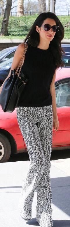 Amal Clooney: Pants – Giambattista Valli Sunglasses – Heidi London Purse – Stella McCartney