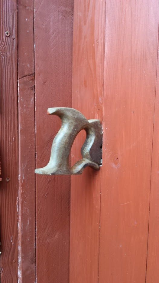 I took the handle from an old saw and turned it into the door handle on my workshop