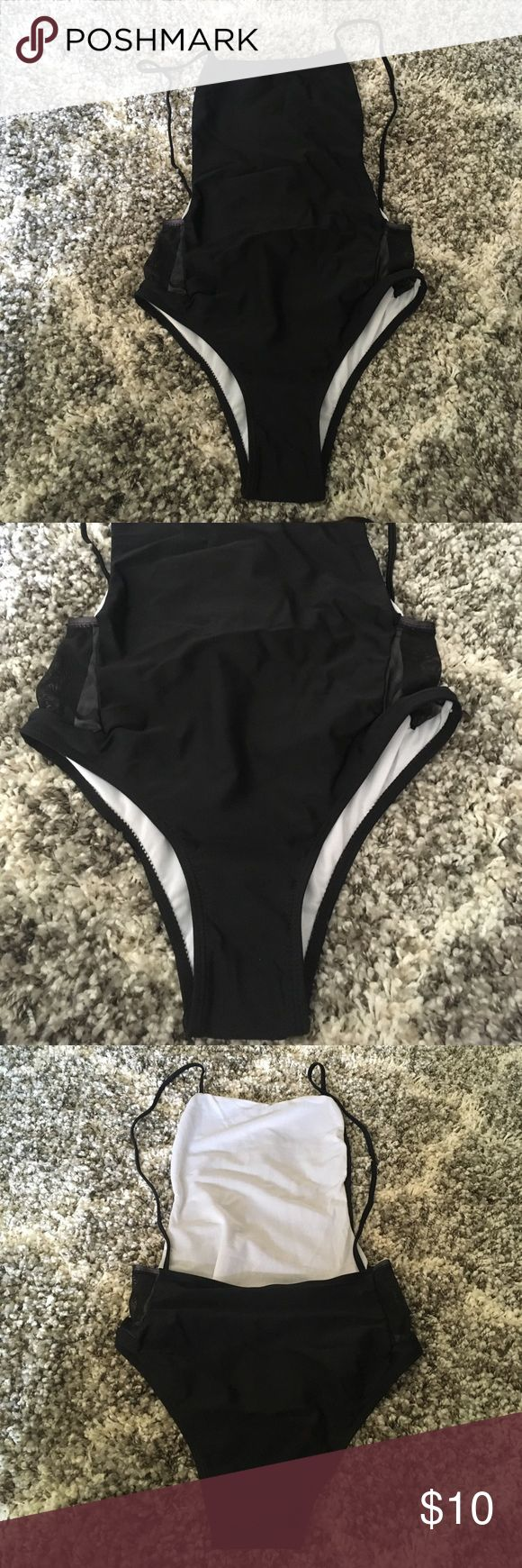 Open back one piece swimsuit Black one piece swimsuit with mesh sides at hip and square neck. Open back. Size large but for a petite build. Large chest not recommended Boohoo Swim One Pieces