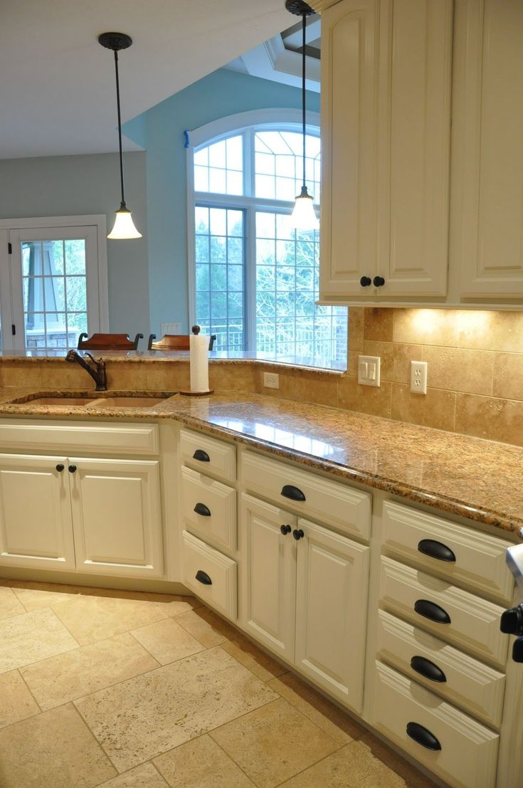 Painting kitchen cabinets before and after for Cream kitchen paint ideas