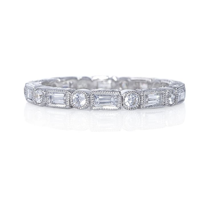 Wrapped in fine milgrain detailing, this baguette and round diamond eternity band presents a geometric spin on classic wedding bands and fits perfectly with most engagement rings.