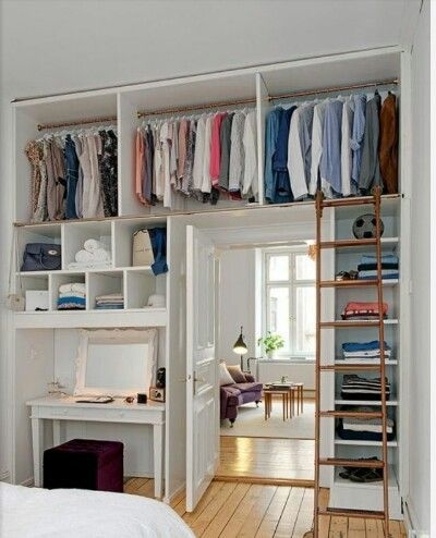 Good idea for a small room without closets, won't look as cluttered walking in either. European style :)