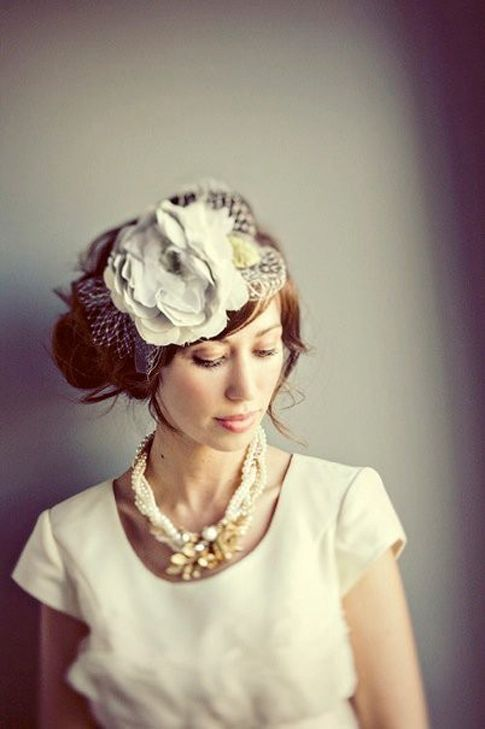 add a brooch to a twisted pearl necklace. <3 the headpiece!