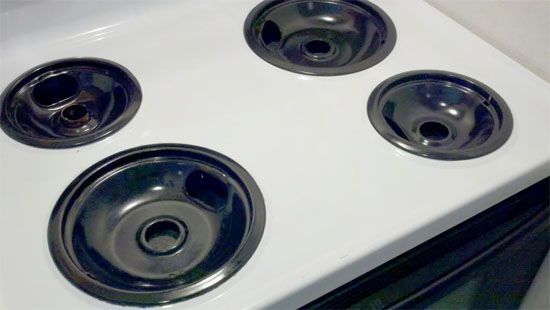 Seal stove burners in separate zip-loc bags with a splash of amonia.  24 hours later, rinse, scrub with a paste of Hydrogen Peroxide and Baking Soda on the stubborn grime and VOILA!