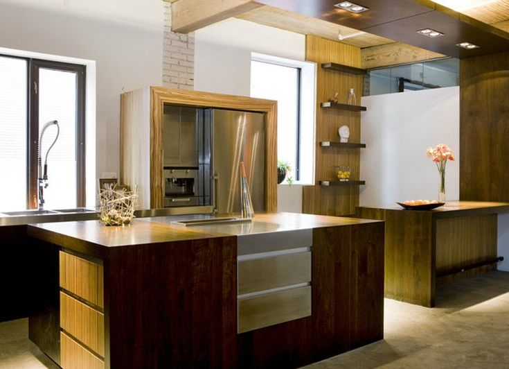 I don't entirely understand this kitchen (is that really a concrete floor just for the place you stand the most?) but I'm intrigued by it.