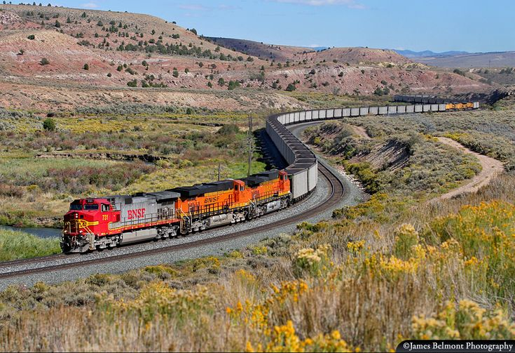 https://flic.kr/p/211jphA | Savage Coal Train at Kyune | A lengthy Union Pacific Savage coal train zigs and zags along the Price River between Kyune and Colton, Utah the afternoon of Sept. 10, 2010. A three unit manned swing helper can be seen emerging from the second s-curve.