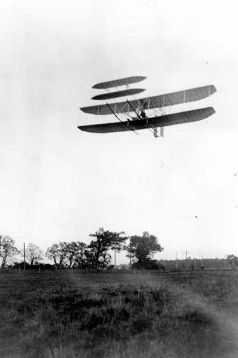 October 5, 1905: Wilbur Wright pilots the Wright Flyer III in a circling flight of 24 miles in 39 minutes near Dayton, Ohio, a world record that would stand until 1908.