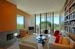 Floor-to-ceiling glass walls take advantage of the Bel Air views.  Source: Zillow