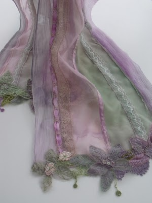 Scarf in shades of lavender and jade.