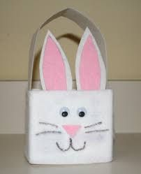 A recycled milk or juice carton painted and decorated like a bunny.