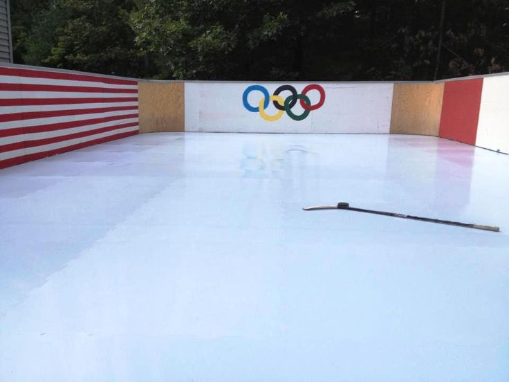 Nice SmartRink synthetic ice backyard rink built on a wooden platform