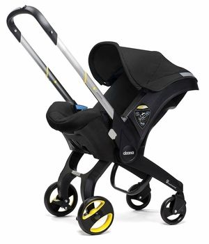 Your baby will be the coolest on the block in this brand new @Doona #CarSeat #Stroller (yes, a car seat that turns into a stroller! Goodbye carryinga  heavy car seat). Love this black color with pops of yellow! #blackandwhite #pishposhbaby