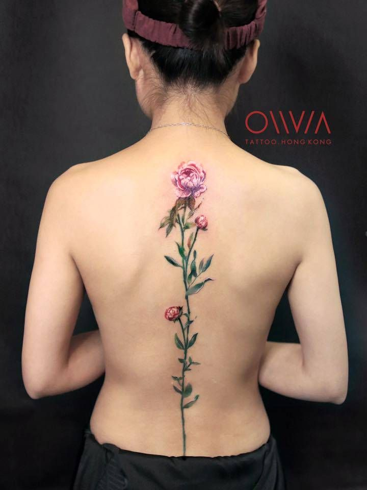 Pink peonies on the spine. Tattoo Artist: Olivia Wong