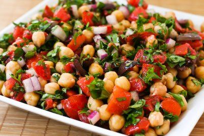 chickpea salad with tomatoes, olives, basil and parsley