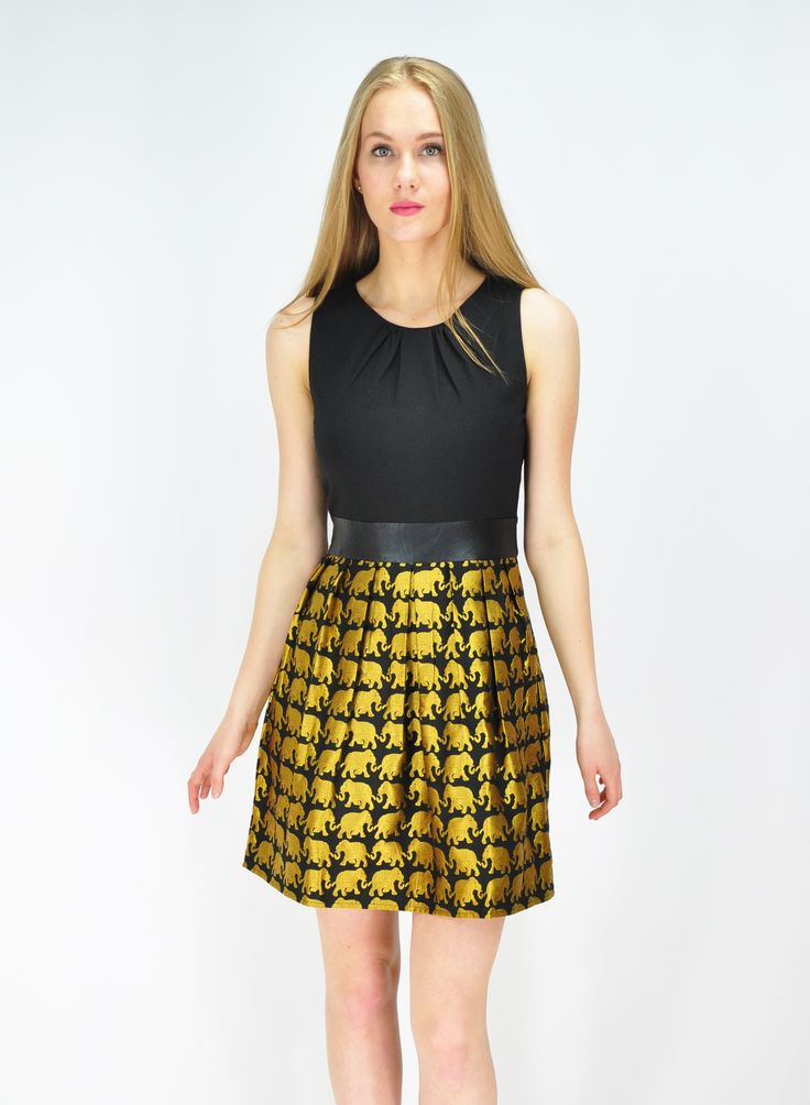 Waist high, gold elephant patterned skirt with a black sleeveless top and waist belt by Goldkid Lonson