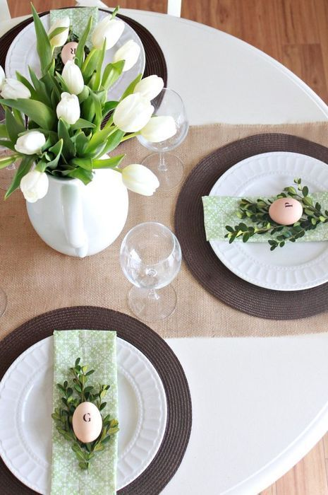 Beautiful Easter dining room table decoration, with eggs and flowers.