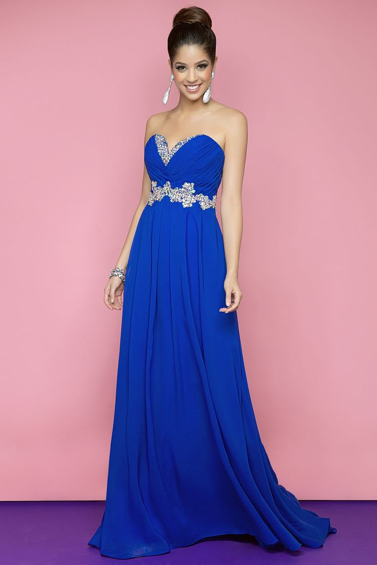 Sexy prom dress with crystals and chiffon! Silver and clear jewels define the pleated bust in this stunning gown.