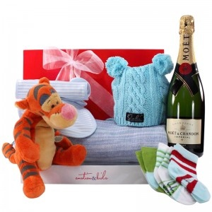 $189.99 - Congratulate new parents; with a blue baby boy gift hamper featuring a Tigger teddy, snug baby blanket, snug knitted hat, bib set, Oobi socks and a bottle of Moët & Chandon Champagne. #babygift #newborn #babyblanket #babyboy #babyclothes #stuffedanimal #tigger #champagne #giftbox