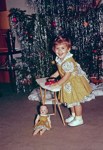 Vintage Christmas photo - little girl with doll and toy ironing board