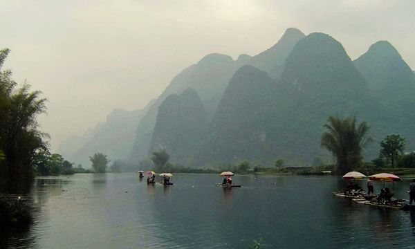 The photo shows the scenery of Yulong River in Yangshuo County of Guilin, south China's Guangxi Zhuang Autonomous Region. The World Heritage Committee on Monday inscribed an extension of South China Karst, a natural World Heritage Site since 2007, into the UNESCO's World Heritage List.