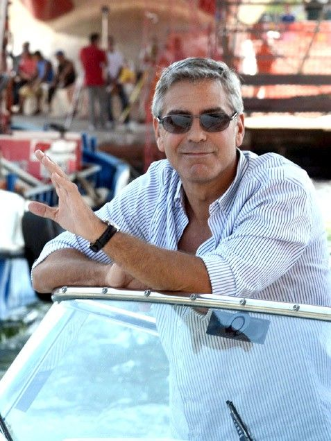 Swoon! George Clooney kicks back on a boat in Venice, Italy