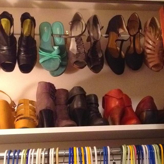 Cheap version of the crown molding shoe rack. Such a great space saver! Made it with curtain brackets and an inexpensive tension rod. Won't work for every pair of heels,  but still worked for most of mine!
