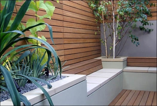 Pure, sleek, elegant. Changes in height & contrast of materials add interest. Horizontal fencing & decking add a sense of space. Planting is simple & architectural. It really doesn't have to be complicated!