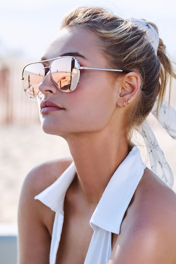 The Quay High Key Gold and Yellow Mirrored Aviator Sunglasses will leave you feelin' cool on those hot, sunny days! Chic, oversized gold aviator frames hold yellow mirrored lenses. Protective pouch included.