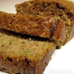 A moist and delicious zucchini bread flavored with walnuts and cinnamon. Easy to bake and freeze, this recipe makes two loaves.