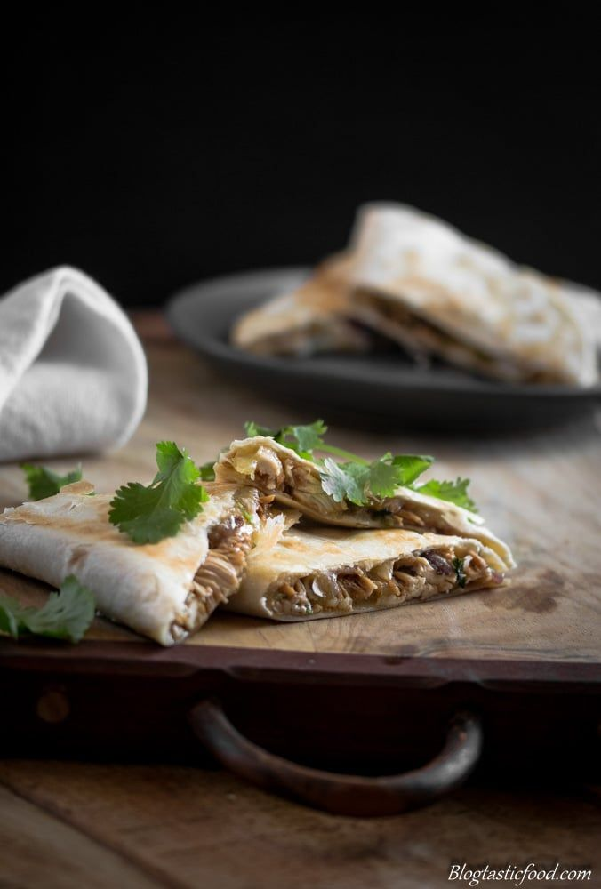 Chicken quesadillas. Golden toasted tortillas filled with gooey melted cheese and pulled chicken that is coated in teriyaki marinade.