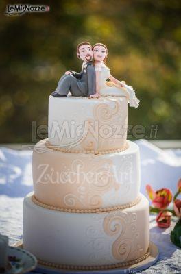 http://www.lemienozze.it/operatori-matrimonio/catering_e_torte_nuziali/torte-di-matrimonio-varese/media/foto/5 Torta nuziale con sposi