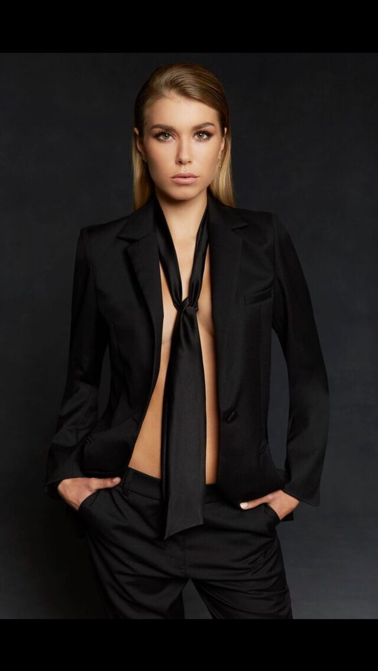 Women's tailored black suit jacket with notched lapel.  From The Aurum Collective's Travel Collection. Made for the business woman on the go.